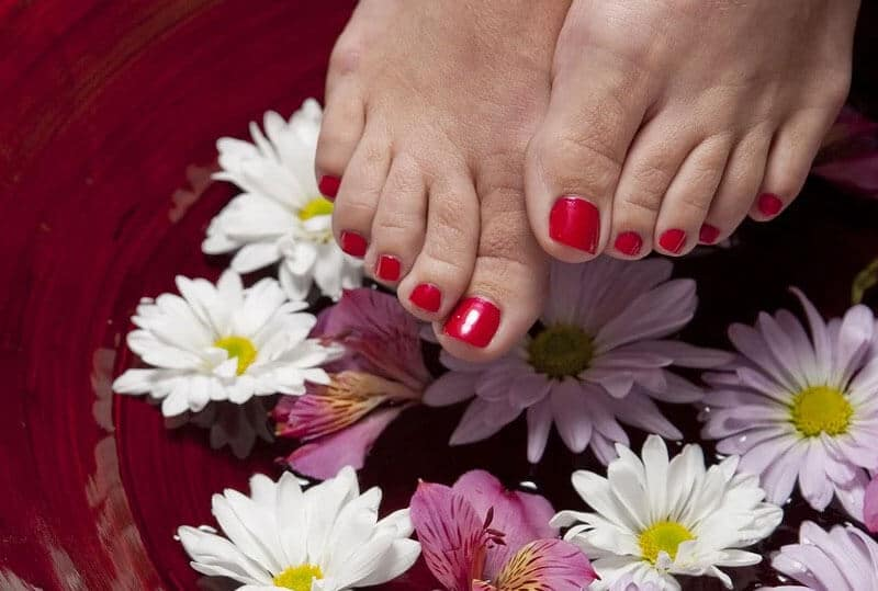 feet with a flower background