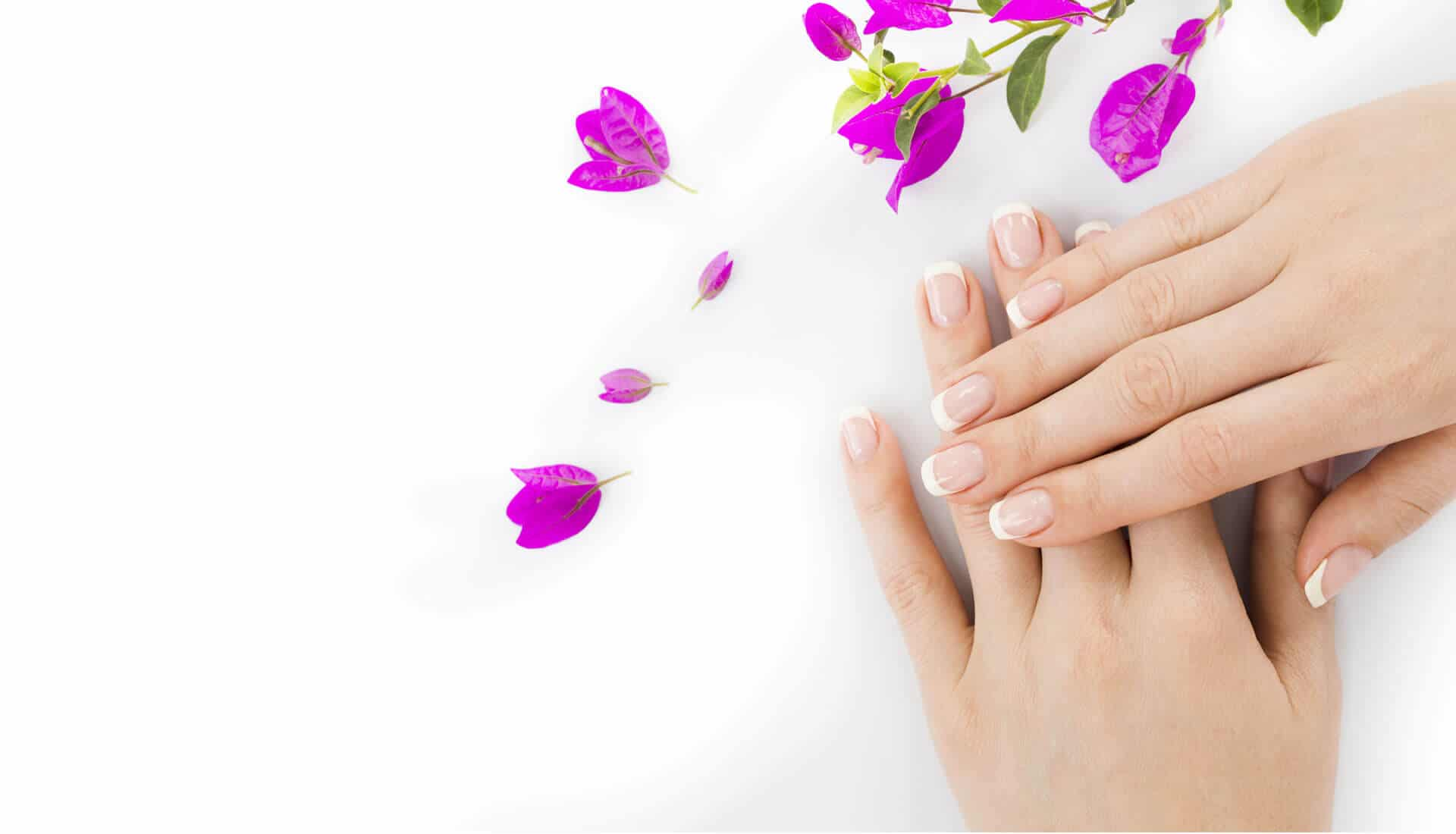 Women show her nails in nail treatment center
